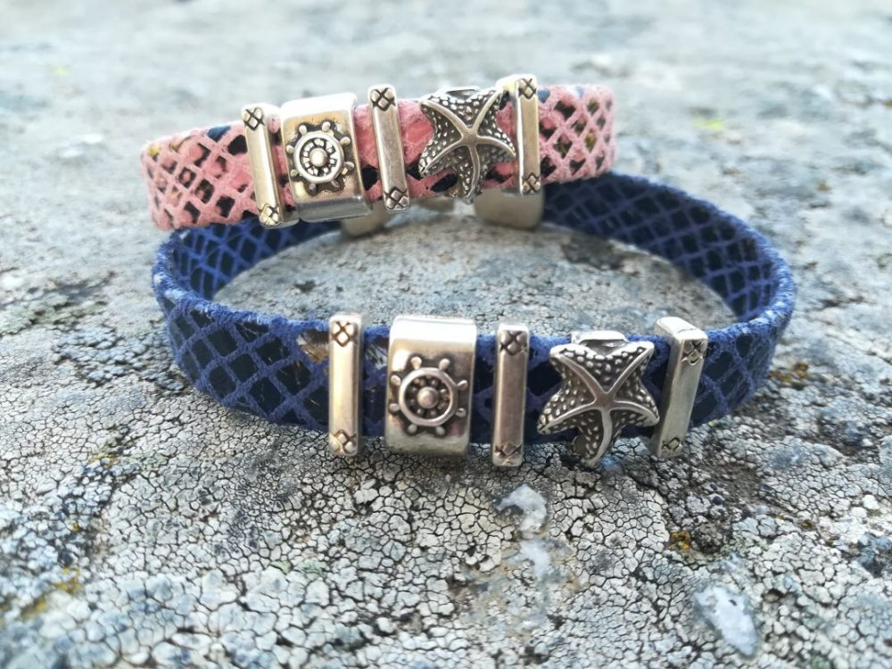 pulsera artesanal piel rosa con ancla, pulsera artesana cuero imitacion reptil, brazalete artesano con estrella mar, pulsera nautica de piel artesanal leonika piel